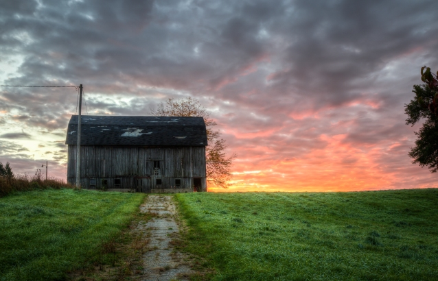 A dramatic sunrise on the old farmstead on Honey Creek Road #sunrise #puremichigan #puremittigan #oldbarns