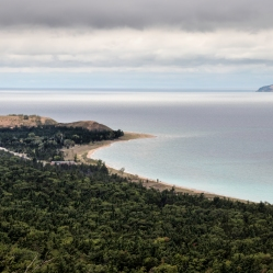 Sleeping Bear Point with South Manitou Island in the distance, as seen from the Islands Overlook on the Alligator HIll Trail at Sleeping Bear National Lakeshore.