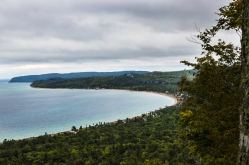 Sleeping Bear Bay with Glen Arbor and the Homestead along the shoreline, as seen from the Islands Overlook on the Alligator HIll Trail at Sleeping Bear National Lakeshore