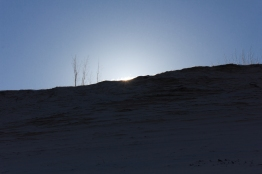 The sun rising over the dune at Sleeping Bear Point.