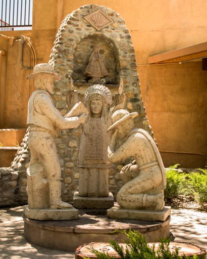 """Three Cultures Monument"" depicts the meeting of a Native American, a white cowboy, and a Hispanic vaquero."